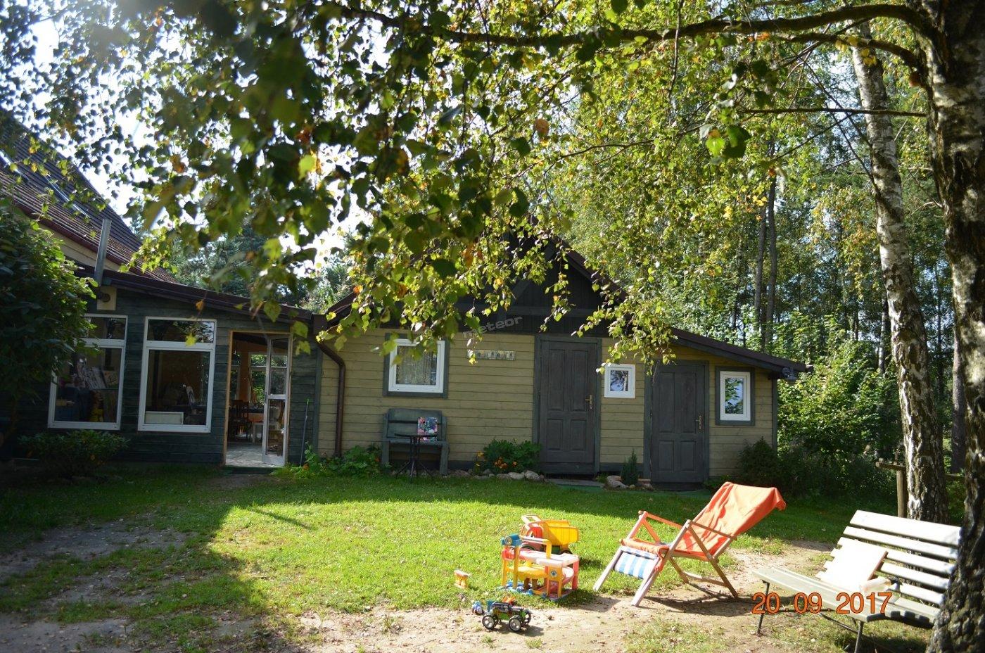 drewniany domek-apartament i pokój -studio
